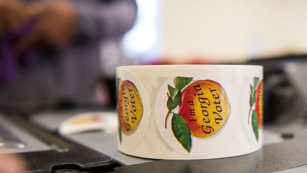 Stickers waiting to be handed out during Georgia's much anticipated runoff election in Evans, Ga., Tuesday morning January 5, 2021. Republican Sens. Kelly Loeffler and David Perdue are being challenged by Democrats Jon Ossoff and Rafael Warnock in Tuesday's runoff.