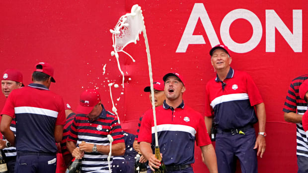 Sep 26, 2021; Haven, Wisconsin, USA; Team USA player Bryson DeChambeau celebrates after the United States beat Europe for the 43rd Ryder Cup golf competition at Whistling Straits. Mandatory Credit: Kyle Terada-USA TODAY Sports