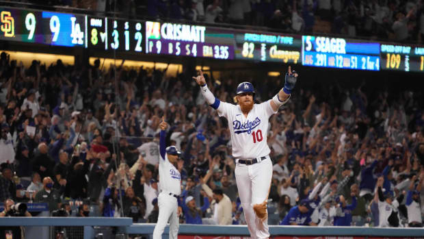 Sep 29, 2021; Los Angeles, California, USA; Los Angeles Dodgers pinch hitter Justin Turner (10) celebrates after scoring on a two-run home run by shortstop Corey Seager (not pictured) in the eighth inning against the San Diego Padres at Dodger Stadium. Mandatory Credit: Kirby Lee-USA TODAY Sports