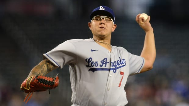 Sep 26, 2021; Phoenix, Arizona, USA; Los Angeles Dodgers starting pitcher Julio Urias (7) pitches against the Arizona Diamondbacks during the first inning at Chase Field. Mandatory Credit: Joe Camporeale-USA TODAY Sports