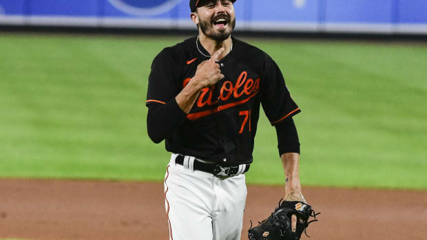 Jul 27, 2021; Baltimore, Maryland, USA; Baltimore Orioles relief pitcher Conner Greene (71) reacts after a pitch during the eighth inning against the Miami Marlins at Oriole Park at Camden Yards. Mandatory Credit: Tommy Gilligan-USA TODAY Sports