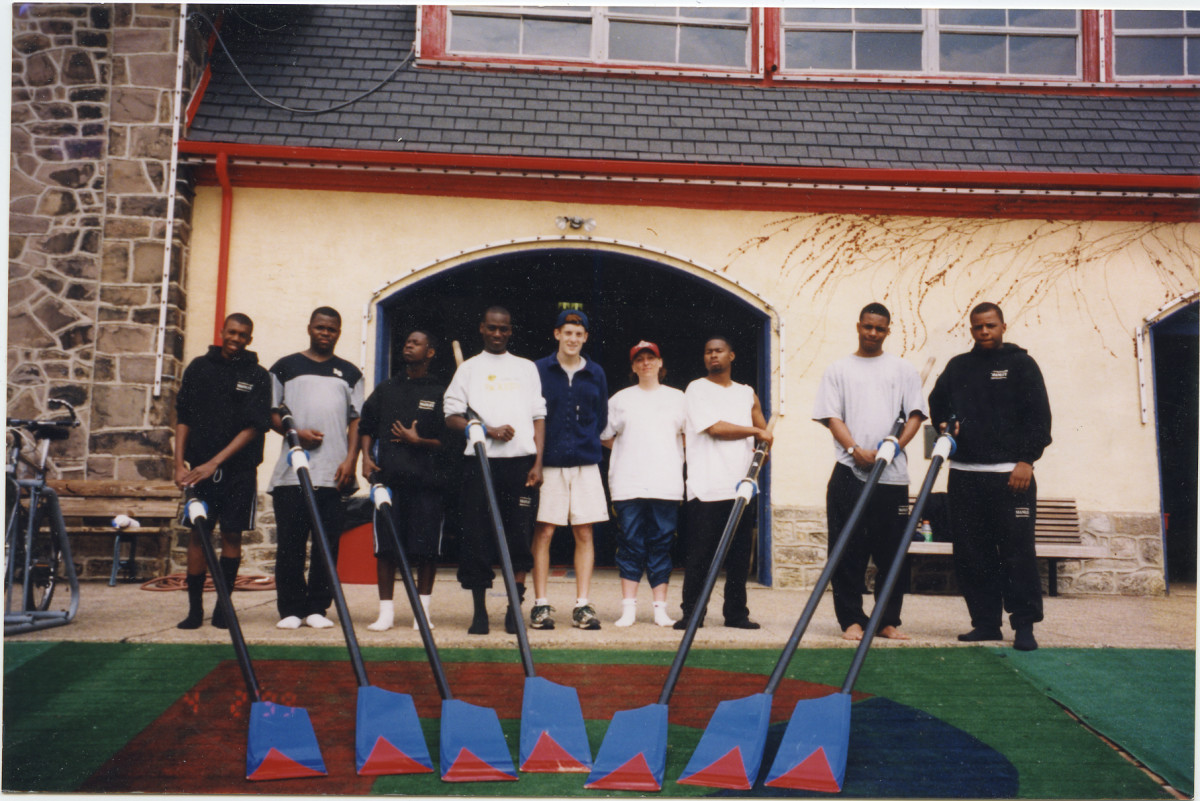 The Manley Crew in front of a boathouse. © 1999 Marc Mandel Courtesy of 50 Eggs Films.