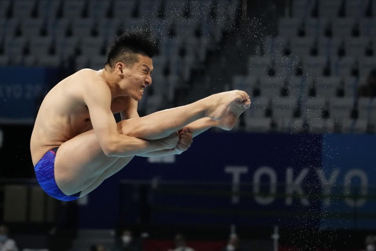 Aug 3, 2021; Tokyo, Japan; Ken Terauchi (JPN) in the men's 3m springboard diving semifinals during the Tokyo 2020 Olympic Summer Games at Tokyo Aquatics Centre. Mandatory Credit: Rob Schumacher-USA TODAY Sports